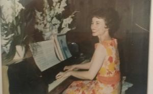 Photo of My Grandmother playing the piano and smiling (beaming, really)