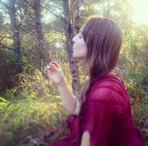 Kimberly Blowing Dandelion
