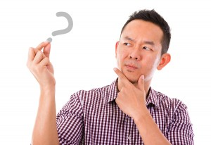 Asian man hand holding blank sign with unsure face expression, i