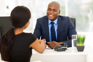 successful african american businessman handshaking with client